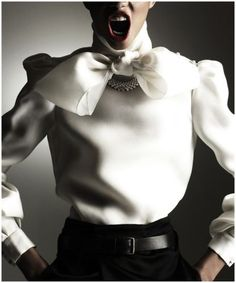 White blouse with neck tie + Black trousers. Classic.