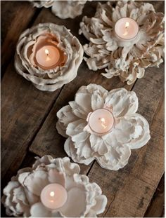 plastic flowers dipped in plaster. beautiful votive holders Design Mom
