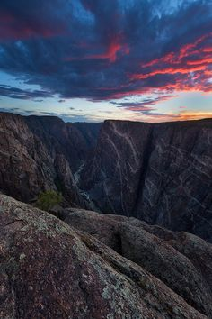 """Painted Wall by Ron Coscorrosa via 500px. """"Black Canyon of the Gunnison, Colorado is one of the most underrated national parks in the entire US. I don't understand why this place isn't more popular. This was taken a few weeks ago at sunset while chasing some wildflowers and monsoon light."""""""