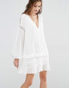 Stevie May Tie Me Down Mini Dress: Textured cotton Plunge neckline  Blouson sleeves  Tied cuff detail  Sheer inserts  Ruffle trim edges  Regular fit - true to size  Machine wash 100% Cotton