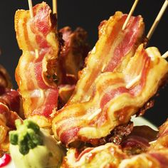 For a garden party, appetizers served on skewers are the best idea! Easy to make, easy to eat, and a minimal amount of dishes to wash! Try these amazingly crispy snacks – bacon and puff pastry filled with cheese, folded and baked on skewers!