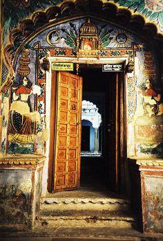 Elaborate, colorful entrance door opening to others - Bundi, India