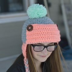 4b72137b8fd Women s Button Trapper Hat - Crochet this fun and cozy hat this winter with  this free crochet pattern.