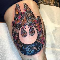 Millennium Falcon and Rebel Alliance Starbird logo tattoo on the left thigh.