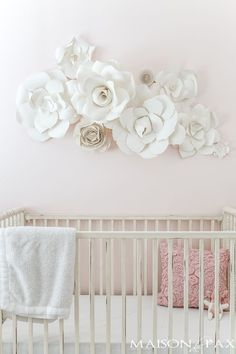 Paper Flowers as Wall Decor in a Nursery: what a gorgeous, soft, feminine space! Almost all neutral, a very pale blush on the walls and soft, natural paper flowers over the crib... Click for details on the paper flowers!