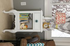 This side table was a Craigslist find! It was re-painted and a @Vicki Snyder Barn Kids knob added. #nursery #DIY