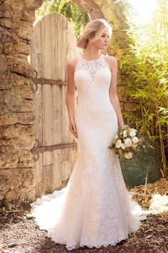 Style D2174  Each detail of this lavish satin wedding gown is meticulously designed to give you the gown of your dreams. The halter neckline & back feature gorgeous illusion lace detailing.