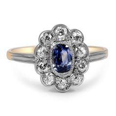 The+Sky+Ring+from+Brilliant+Earth  This delightful sapphire and diamond ring from the Art Deco era highlights a stunning oval sapphire at the center with a halo of exquisite old mine cut diamond accents set atop an ideally detailed band for a feminine, floral presentation (approx. 0.40 total carat weight).
