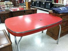 Very cool vintage kitchen table.  Arvins made with pop up leaf.