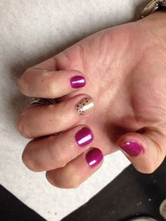 Purple with tan and brown mauve purple gold glitter poke a dot design on accent nail  Oasis Salon and Spa Mill Hall Pa (570)726-6565