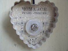 Altered Cookie Cutter Heart Ornament.  Cookie cutter, sheet music, glitter, buttons......so simple but very charming