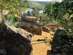 elaborate outdoor living space- gorgeous wood deck and huge boulders