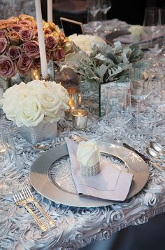 Ideal for the glamorous couple, a single rose bud is wrapped in crystal trim and placed atop a lavender hemstitched napkin.