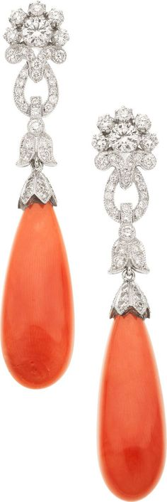 Coral, Diamond, White Gold Earrings  The earrings feature teardrop-shaped coral cabochons, surmounted by full-cut diamonds weighing a total of 1.48 carats, set in 18k white gold, completed by posts and friction backs. Gross weight 12.30 grams.