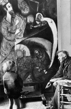 """Marc Chagall with a child in front of """"King David"""" by Felix H. Man"""