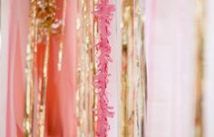 Pink and gold streamers make a super cute background for a photo booth, bridal party table, etc.