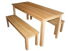 Handmade Solid Oak Dining Table and Two Benches from Wolds Wood This set is all solid Oak construction the tops being 25mm thick You can choose from