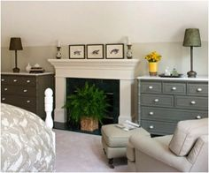 Instead of bookcases beside a fireplace, why not try two chests?