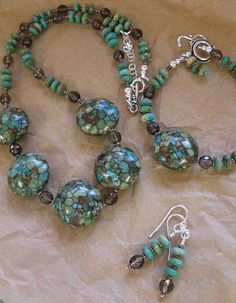 Turtle turquoise ( a mosaic turquoise), smoky quartz, turquoise and sterling silver.
