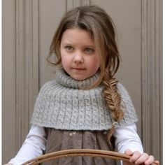Havana Cape is a great accessory for kids to pull over their clothes if they are just a little cold. Easier to manage than a scarf and comfortable to wear, this will quickly become a favourite. Knitted in the round with a 4 row repeat this is perfect knitting whilst watching the latest Scandinavian drama. Knitted on 4 and 5 mm circular needles. Tension: 22 sts and 24 rows over 10 cm square using 5 mm needles in cable rib. To fit the following chest sizes: Aged 3-6 years: To fit approx…