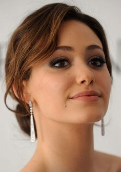 Emmy Rossum Long Hairstyle: Classic Bun for Party