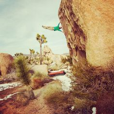 Sonnie Trotter throwing a flag on the classic and committing boulder problem Planet X in Joshua Tree National Park, California. Photo by Ben Moon