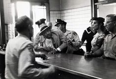 """Dr. King continued to fight for what he believed in and as we see in this next photo by Charles Moore, he is being arrested by police in 1958 for loitering in the in the vicinity of the Montgomery, Alabama Recorder's Court. The charge was later changed to """"Failure to obey a police officer."""""""