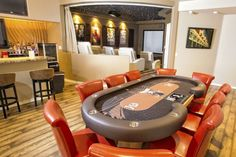 One day I'll be rich enough to have a table like this and cinema room :-)