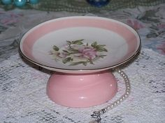 Homer Laughlin saucer, pink candle holder, come together to make this little cupcake plate stand pedestal. Possibilities for candle holder, jewelry holder, candy dish, soap dish, etc