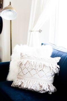 home tour of Amanda Holstein's san francisco studio apartment, home decor inspiration, home office, coastal style, bright bohemian living room idea, gold lamp, navy blue couch, anthropologie pillows, moroccan pillows, boho pillows