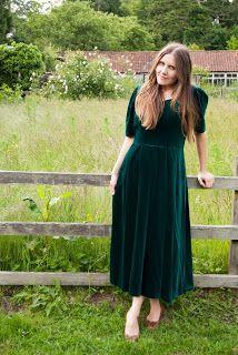 A Dark Green Velvet Dress Trimmed With English Netting