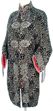 "c. 1880's Victorian Black Beaded Dolman Mantle Lined in Red Satin!  :)  Black cut velvet base  covered with jet black beads creating an exquisite pattern.  Large jet black bead medallions adorn the cuffs, and drip down the front of this piece.  limited movement of the arms in this dolmans as they are cut with batwing sleeves. Fully lined in ruby red silk satin.  Measures: 33-35"" bust, 39"" long."