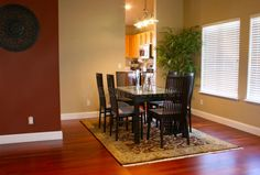 Photo about Modern Dining Room with Table and Chairs on Rug with Hardwood Cherry Floor. Image of cherry, flooring, architecture - 18728695 Cherry Hardwood Flooring, Dining Room, Dining Table, Dining Chairs, Cozy Fireplace, Table And Chairs, House Colors, New Homes, Room Decor