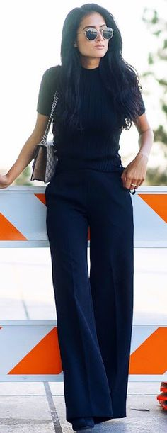 Office look   Simple black top with flared pants and Lennon sunglasses