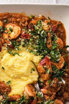 NYT Cooking: Shrimp with hominy grits is a favorite in the American South. Polenta stands in for this spicy Italianate version, fortified with hot fennel sausage and tomatoes. For the best-tasting results, be sure to cook the polenta slowly for at least 45 minutes, and try to get freshly made sausages from an Italian deli or butcher shop.