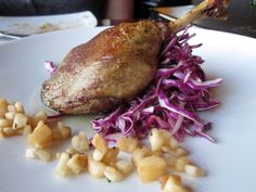 Cafe Vino Duck Confit – Maple Leaf Farm's duck thigh and leg, marinated red cabbage, house pickled Gala apple and yuzu honey ginger reduction