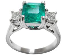 Emerald and two princess cut diamonds rings