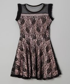 Polished charm meets playful style with this lacy frock. Smooth lining beneath the sheer top keeps this mod look comfy and cool while preventing the need for a slip.95% polyester / 5% spandexMachine wash; hang dryMade in the USA