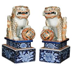 A Large pair of Japanese Porcelain Foh dogs on Plinths, Meiji | From a unique collection of antique and modern ceramics at http://www.1stdibs.com/furniture/asian-art-furniture/ceramics/