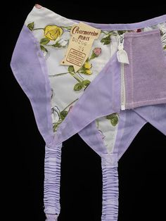 Charmereine - Suspender - 1960's. From the Victoria & Albert Museum. With nylon becoming more popular, you begin to see experiments in color and printing.