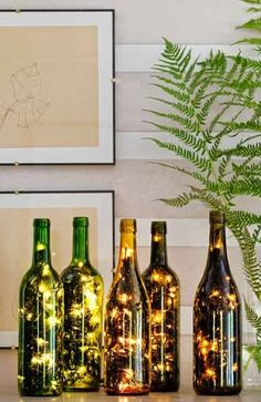 How to make a festive light display with your empty wine bottles. Feed a 50-light string (get the kind with just one plug) into a hole drilled in a bottle's side. We used a ¾-inch tile bit, then enlarged and smoothed the hole with a conical grinding stone.