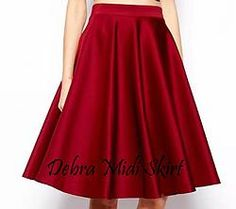 Debra Midi Skirt  Midi- skirt in wavy pattern is a good choice to dress up. Feminine midi skirt...