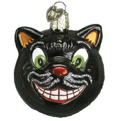 """Grinning Cat Christmas Ornament 26036 Merck Family's Old World Christmas Measures approximately 2 1/4"""" Mouth blown, hand painted, glass Christmas ornament from Merck Family's"""