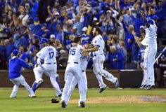 Kansas City Royals players celebrate after winning the ALCS championship by defeating the Toronto Blue Jays 4-3 on Friday, October 23, 2015 at Kauffman Stadium in Kansas City, Mo.