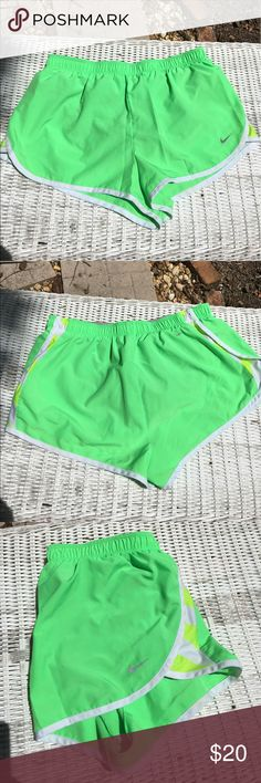 "🆕Nike dry-fit electric green athletic shorts Nike Fri-fit electric green with white and lime stripes at sides. Drawstring waist, grey built in panty & hidden key pocket. EUC inseam 2"" ✅I ship same or next day ✅Bundle for discount Nike Shorts"