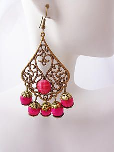 $7.00 Pink Pixie Earrings. Lovely Moroccan inspired earrings, very light weight. Antique bronze color with wooden fuchsia beads and small stone. Shepherd hook style. #PINKEarrings #PINK #Earrings #PINKPixie   #Nonprofit    All of our proceeds go to educating women in crisis. www.pinkpixie.org