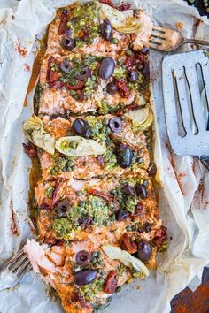 Mediterranean-inspired Salmon in Parchment Paper (or fish en papillote) with sun-dried tomatoes kalamata olives dill capers and artichoke hearts. This easy dinner recipe is paleo keto and packed with flavor! Fish Dishes, Seafood Dishes, Seafood Recipes, Salmon Dishes, Seafood Pasta, Healthy Food Recipes, Cooking Recipes, Yummy Food, Paleo Fish Recipes