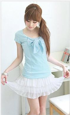 Simply adorable. Cute baby blue bow top with white skirt.