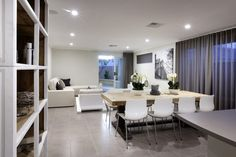 Spacious, open living area with modern lighting and furniture
