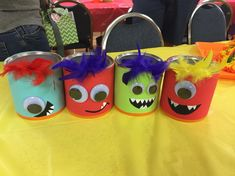 """First Birthday """"Mini Monster"""" themed center pieces made from old formula cans."""